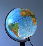 Globe. Blue Earth Globe on a blue background stock photo