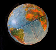 Globe. Blue Earth Globe on a Black background stock image