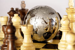 Globe. A globe puzzle is on a chess board Royalty Free Stock Image