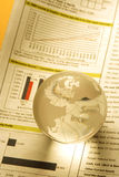 Globe. A crystal globe on a finance document Royalty Free Stock Image