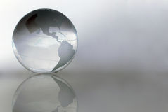Globe. Glass globe with grey background Stock Images
