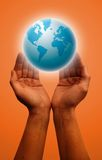 Globe. Hands and earth Stock Image