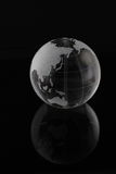 Globe. World globe reflected on a black mirror stock photos