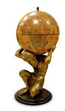 Globe. A sculpture of a man holding a terrestrial globe on his neck royalty free stock photos