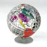 Globe. Brightly Colored Globe isolated on white background Stock Photos