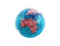 Globe. A small plastic globe, isolated on a white background Stock Images