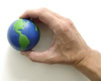 Globe. Hand around earth Royalty Free Stock Photography