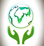 Globe abstract icon with green hands Stock Photography