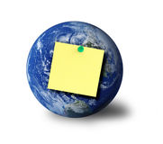 Globe and adhesive note. Globe and  blank adhesive note, shadow at the right side Royalty Free Stock Photos