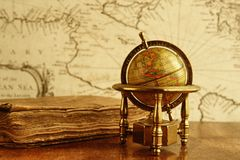 Globe against old map Royalty Free Stock Photos
