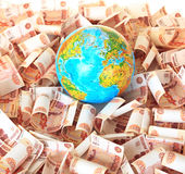 Globe against Russian banknotes Royalty Free Stock Image