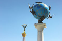 Globe against the sky Royalty Free Stock Photo