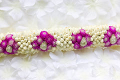 Globe Amaranth and Jasmine garland. Royalty Free Stock Photography