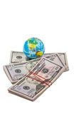 Globe on american dollars Stock Photography
