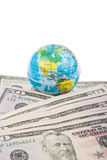 Globe on american dollars Stock Images