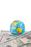 Globe on american dollars Royalty Free Stock Photo