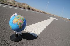 Globe and arrow on a asphalt street to the future Royalty Free Stock Photo