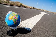globe and arrow on a asphalt street to the future Royalty Free Stock Image