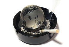 Globe, ashtray, cigarette Royalty Free Stock Images