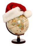 Globe avec le chapeau de Santa (1 de 3) Image libre de droits