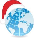Globe avec le chapeau de Santa. Photos stock