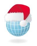 Globe avec le chapeau rouge de Santa Photo libre de droits