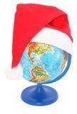Globe avec un chapeau du père noël Image stock