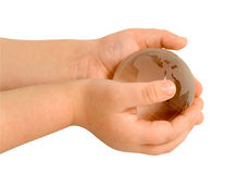 Globe in baby hands. Baby keeps glass globe in hands Royalty Free Stock Image