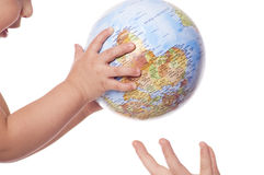 Globe in baby's  hands. Royalty Free Stock Photo