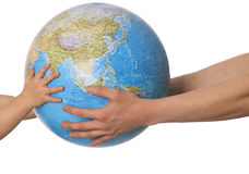 Globe in baby's hands. Royalty Free Stock Photos
