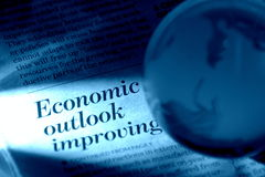 Economy Outlook Improving. Globe with the background of newspaper headline Stock Photography
