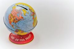 Globe bank to save money or coins piggybank. This is a colorful World`s Fair globe bank with the saying, Save So You Prosper royalty free stock photo