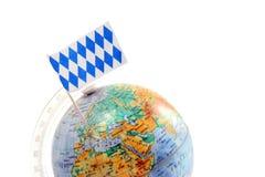 Globe with bavarian flag stucking on bavaria. copy space Royalty Free Stock Photos