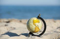 Globe beach Stock Photos