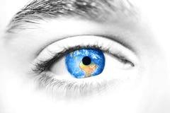 Globe in beautiful eye. Close up shot royalty free stock images