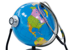 Globe being check with stethoscope on white background Royalty Free Stock Photos