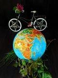 Globe and a bicycle. Travel concept. Environment concept Royalty Free Stock Images