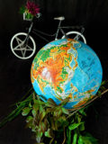 Globe and a bicycle. Travel concept. Environment concept Royalty Free Stock Photography