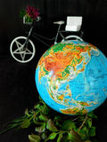 Globe and a bicycle. Travel concept. Environment concept Stock Photos