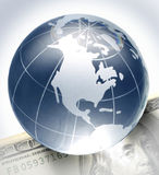 Globe on bill. Glass globe on hundred dollar bill Stock Photography