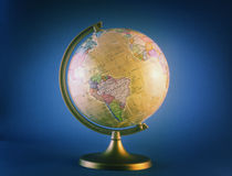 Globe on blue Stock Photography