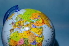 Globe on blue background Stock Photography
