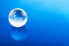 Globe on blue background Stock Photo