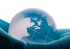 Globe on blue satin Royalty Free Stock Photos