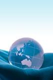 Globe on blue satin Royalty Free Stock Photography