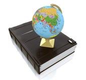 Globe on book Stock Photos
