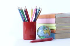 Globe, books and pencils on white background .photo with copy space.  stock photography