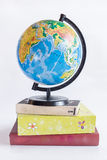 Globe on books. On a white background stock images