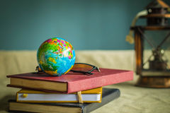 Globe and books at work. Stock Images