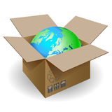 Globe and box. Globe in a cardboard box on a white background Stock Images